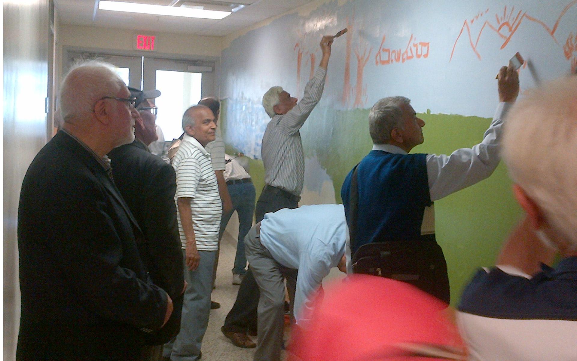Seniors helping to paint Murals